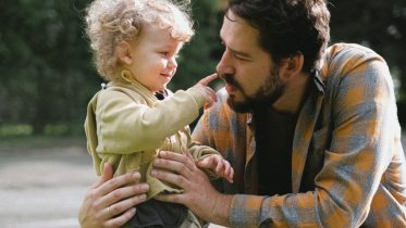 Kid pointing to dads nose